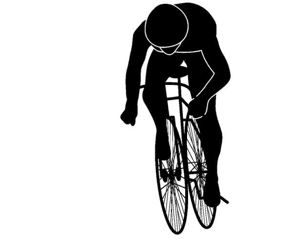 前傾して自転車に乗る人のシルエット